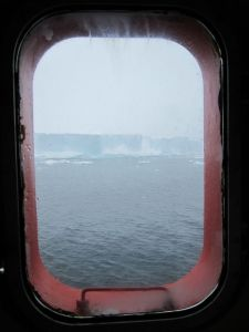 Porthole with Iceberg outside