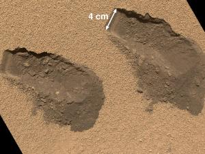 Scoop marks in the Mars soil from analyses conducted by Curiosity.