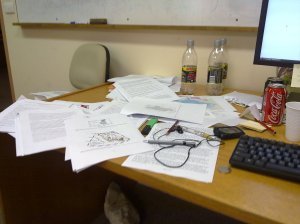 Stacks of various stages of a revised paper. Note the caffeinated beverages.