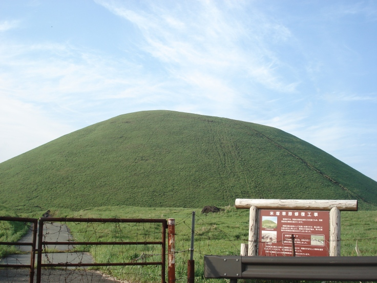 "This inverted rice-bowl shaped hill is apparently known as ""Rice Hill"". Apparently the legend is that the gods made this hill and distributed the rice to the poor peasants (accounting for the dimple at the top). This small volcano is now a cattle pasture."